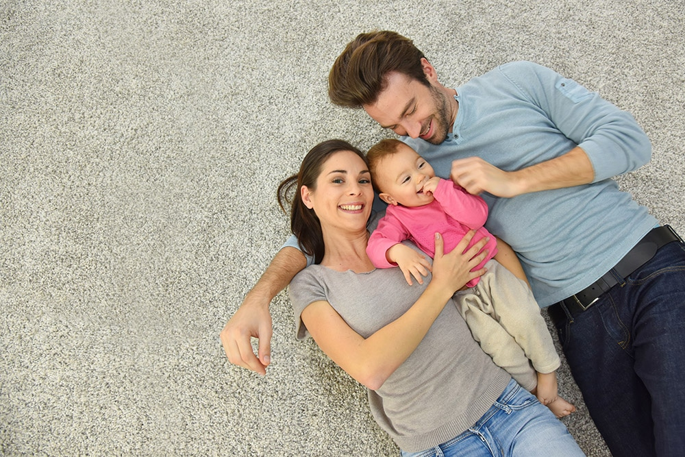 Carpet cleaning services Stirling - family relaxing on fresh carpet