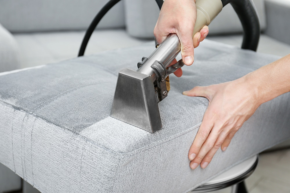 Upholstery steam cleaners in Stirling - removing dirt from sofa