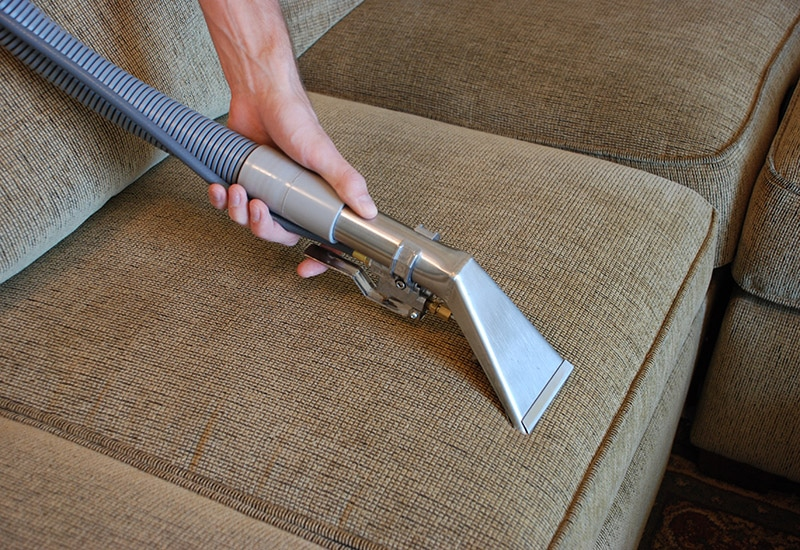 Carpet and upholstery cleaners Stirling - cleaning a sofa